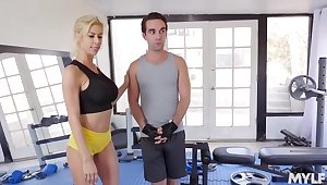 Busty blonde milf, Alexis Fawx is getting hammered in the gym after pursuance a stance of a workout