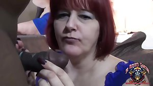 Mature redhead is eating loads of fresh cum check over c pass sucking a big, black meat stick